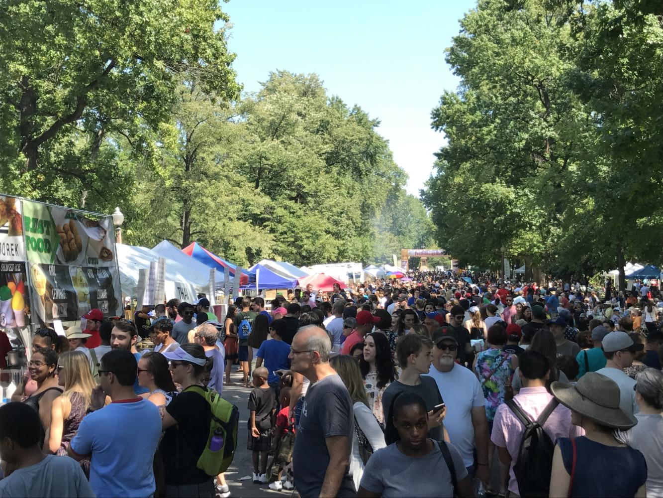 Crowds enjoy the day in Tower Grove Park at Festival of Nations. Photo by Hannah Esker.
