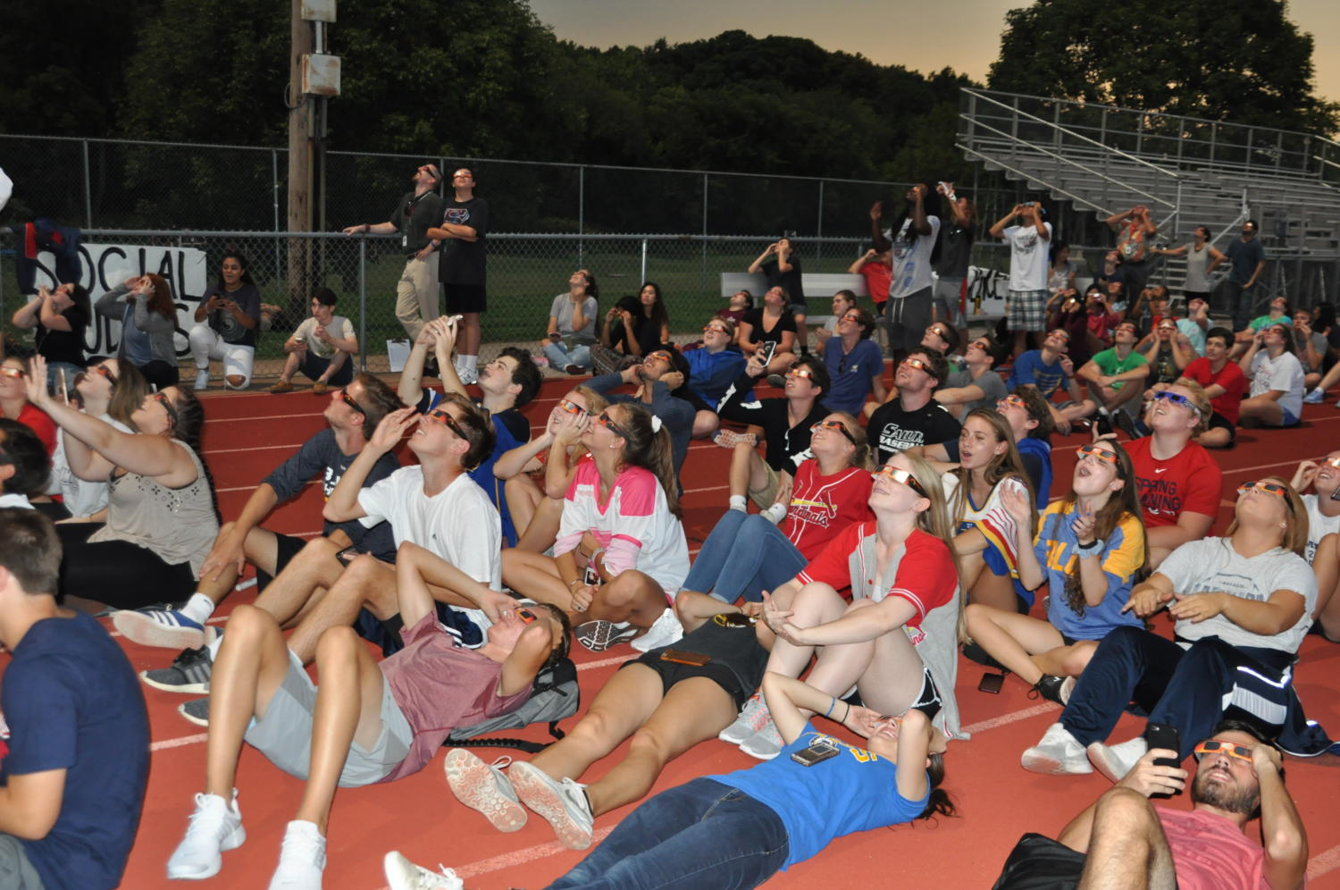 South students look up at the sky with their glasses on during the eclipse, Aug. 21.