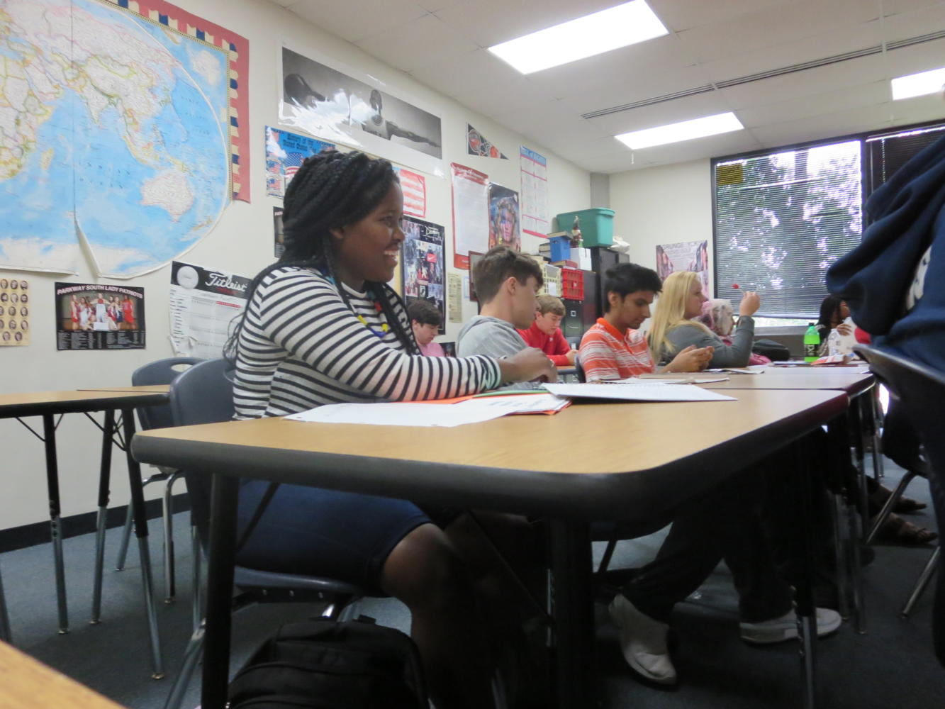 Junior Snegugu Nsimbi listens carefully in Government class. Nsimbi is from South Africa. Photo by Gabby Naucke.
