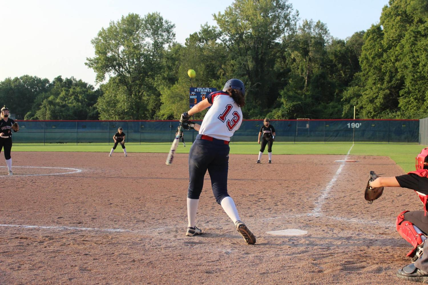 Senior+left+fielder+Amanda+Noser+hits+the+ball+to+the+opposite+field+in+a+game+against+Rockwood+Summit.+Photo+by+Tim+Wahl.
