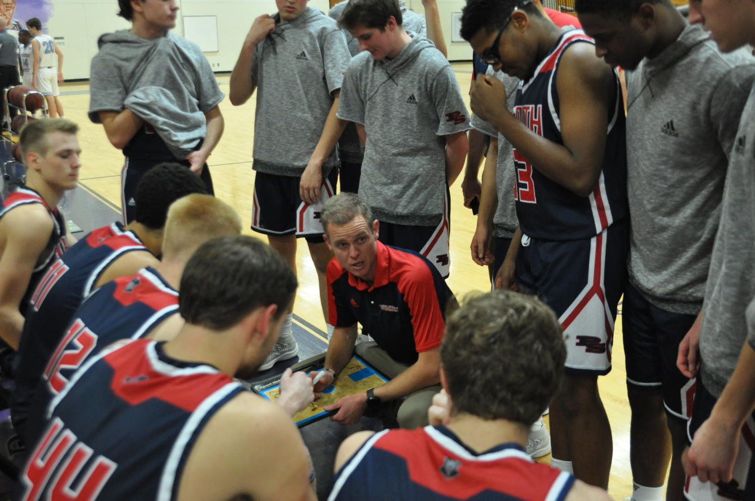 Coach Matt Roach discusses team strategy during a break in the action against West, Nov. 27.