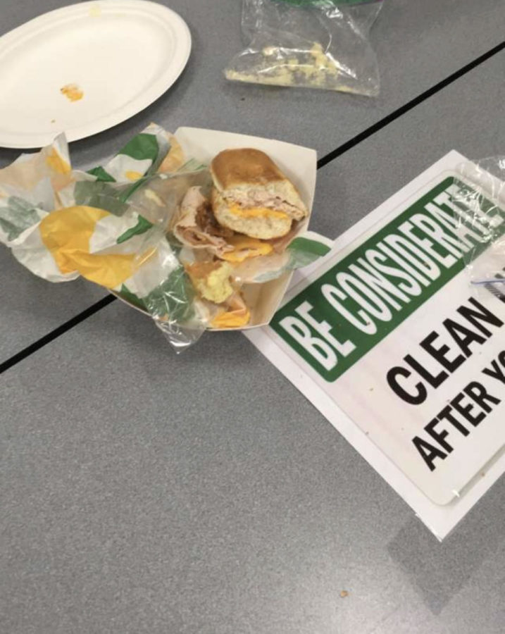 Students+leave+trash+on+their+table+after+fourth+lunch%2C+Nov.+30.