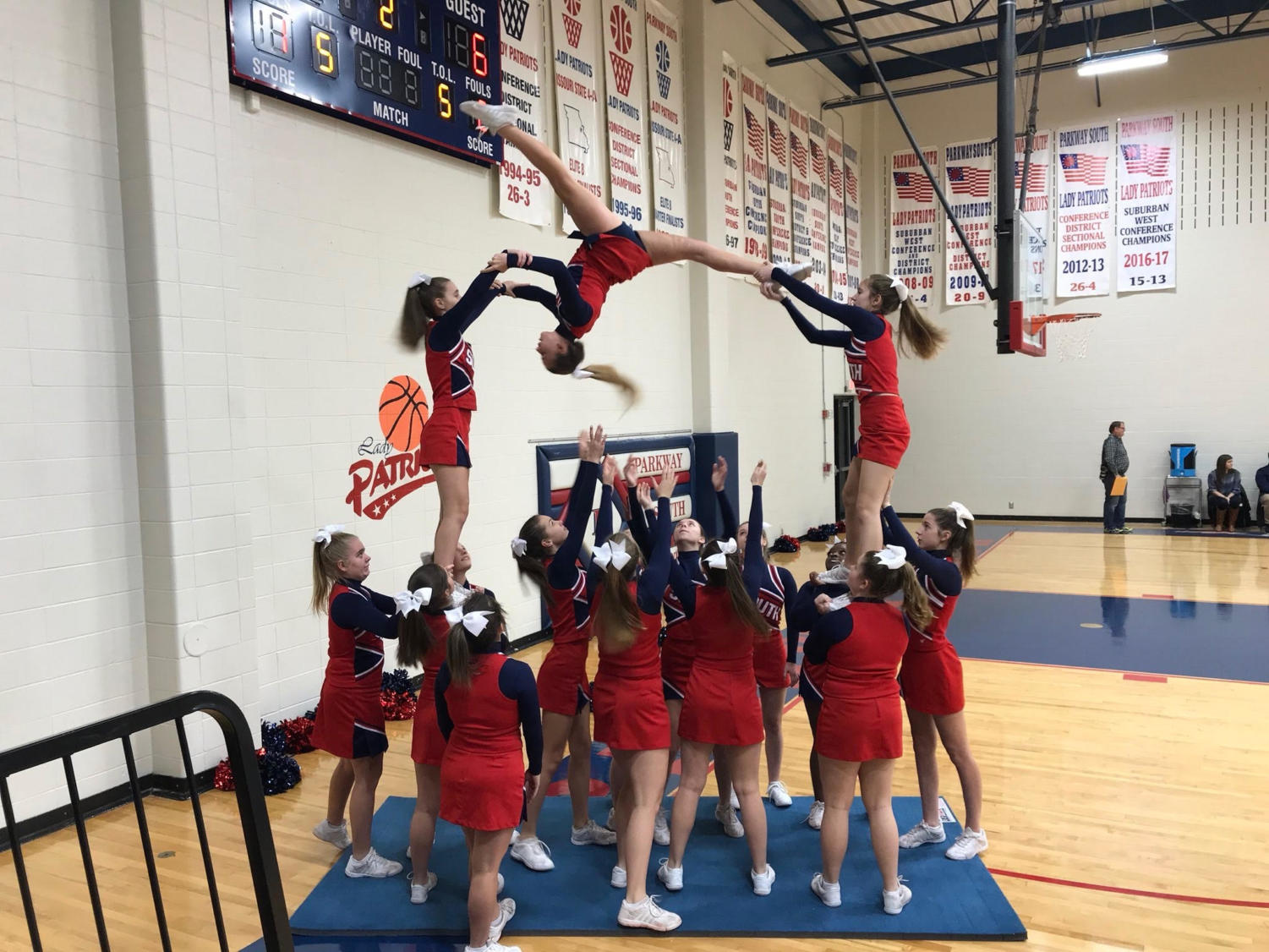 The JV cheerleading squad does its