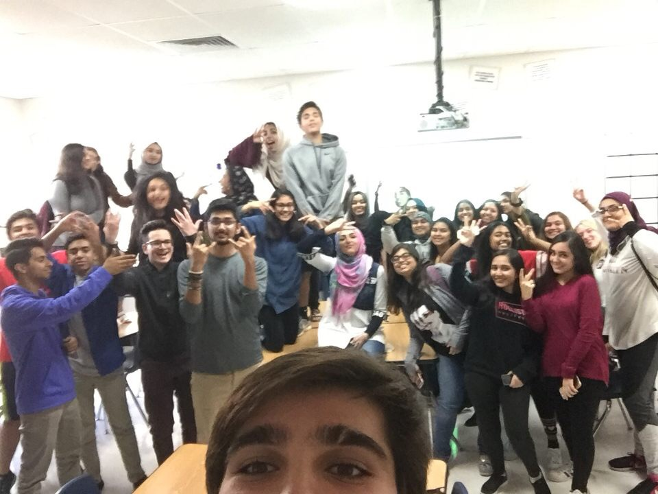 Members of the Muslim Student Association take a selfie during a meeting.
