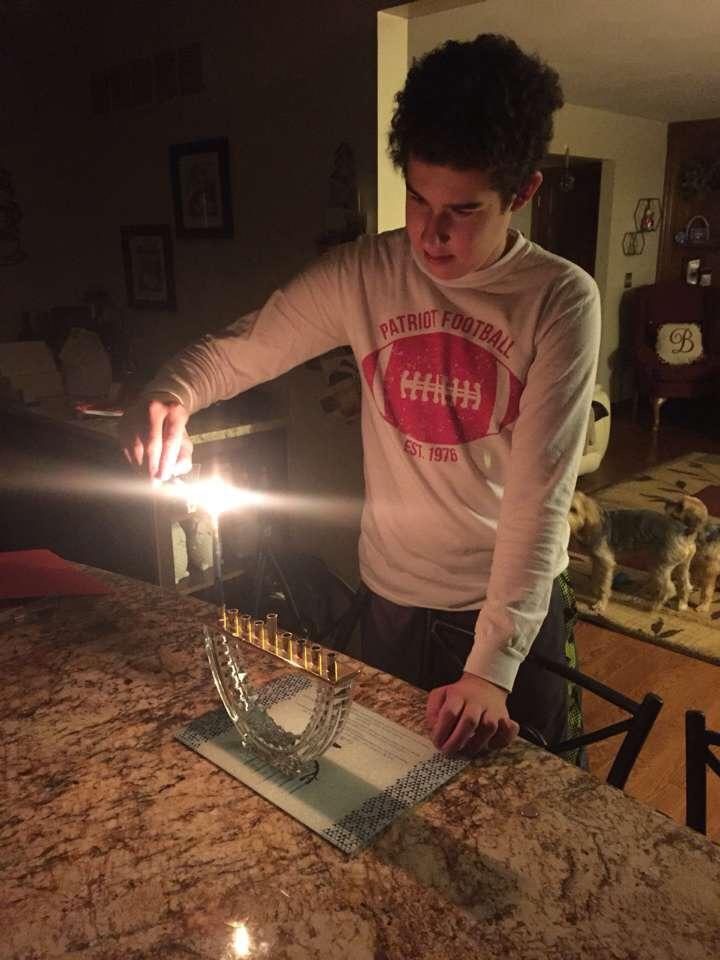 Sophomore Jacob Barbarash lights the Menorah to celebrate the first night of Hanukkah, Dec. 12