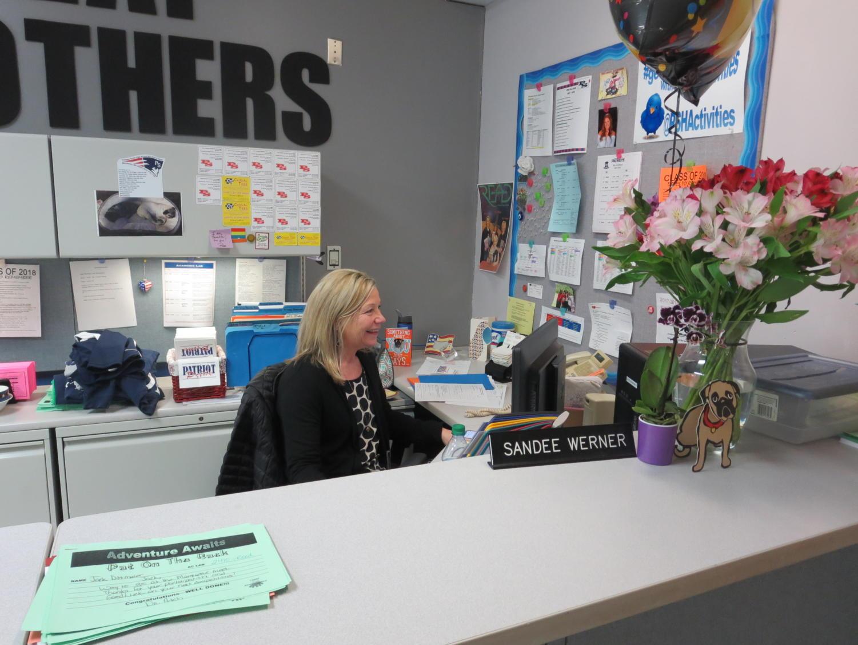 Sandee Werner works at her desk during her last week in the building.