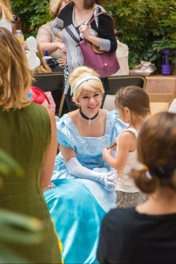 Mikel%2C+dressed+as+Cinderella%2C+smiles+as+she+listens+to+a+little+girl.