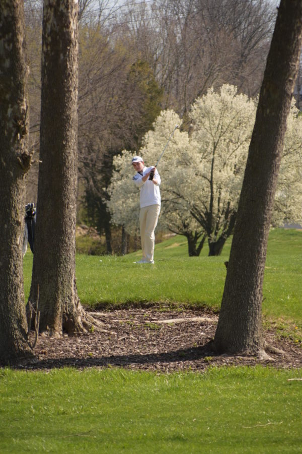 Junior+Paul+Dannegger+tries+to+hit+a+shot+between+two+trees.+