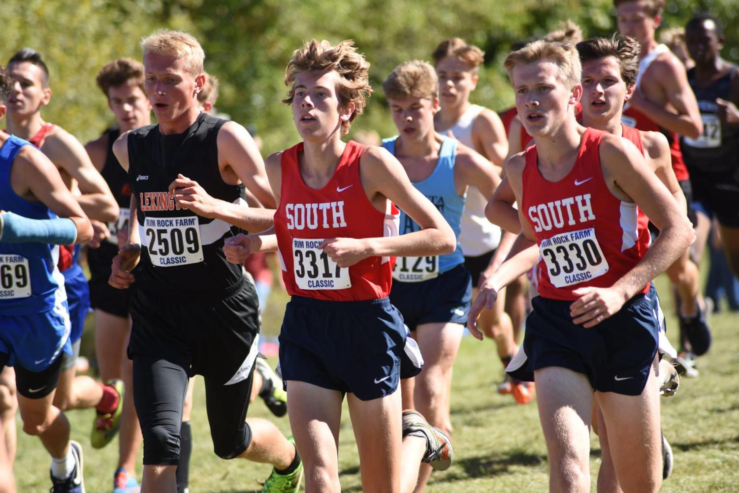(L to R) Eric Boles, Daniel Tabaka, (off Tabaka's left shoulder, to the right in photo in red) and James Stone run together in the first mile of the Rim Rock Farm Classic in Lawrence, Kansas Sept. 22.  South finished twelfth in a field of thirty-five.