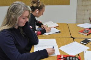 Alyssa Poe studies hard in her 5th block class. Poe is from Australia.