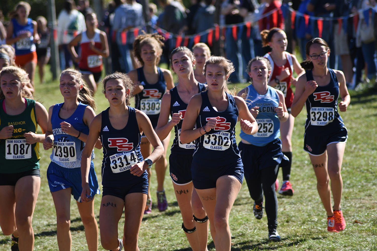 Juniors Vanessa Waidmann, Jordyn Haddrill and Sydney Hieken, and sophomores Mary Gordon and  Abigail Bernath run hard at the Rim Rock Farm Classic in Lawrence, Kansas Sept. 22.