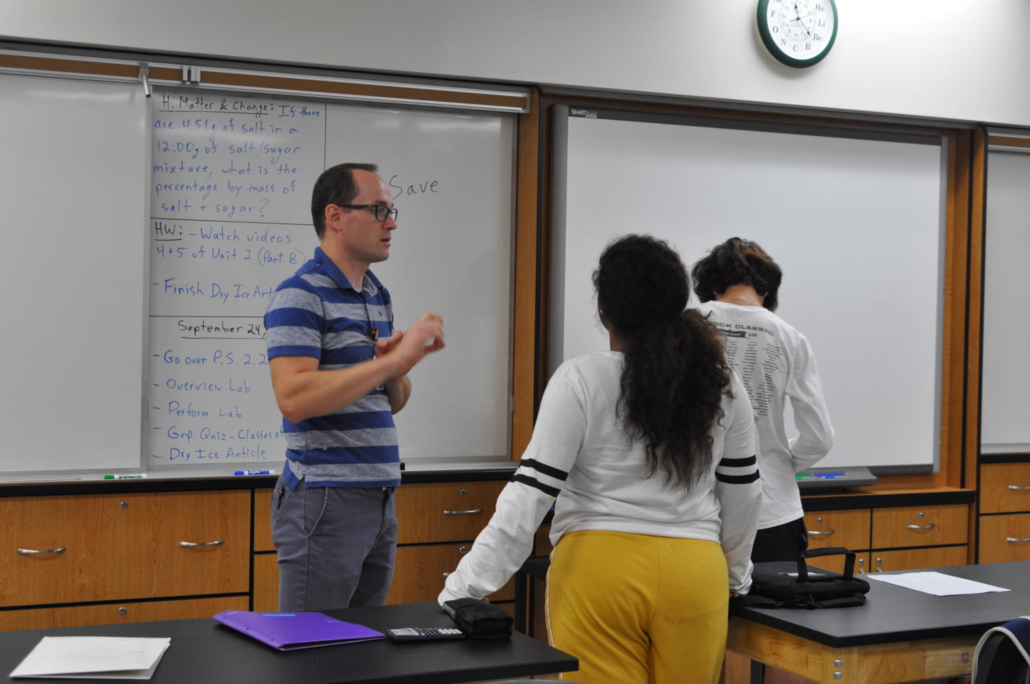 Science teacher Sergey Zinovchik chats with students during class.