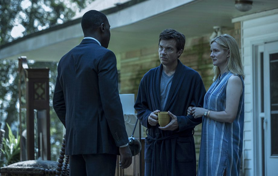 Marty and his wife, Wendy, talk to an FBI agent during an episode of Ozark.