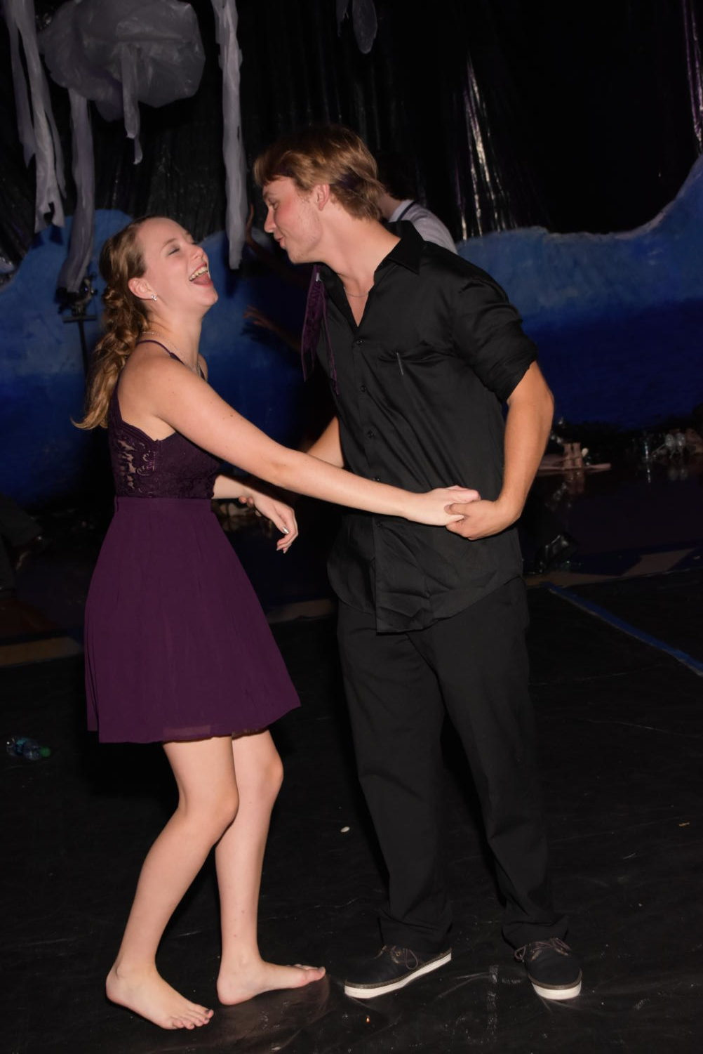 Juniors Audrey Feicht and Caleb Wells share a funny moment while on the Homecoming dance floor.