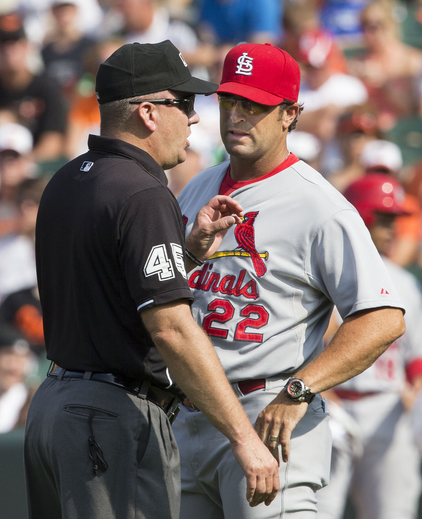 Former manager Mike Matheny argues with an umpire. He was fired in July.