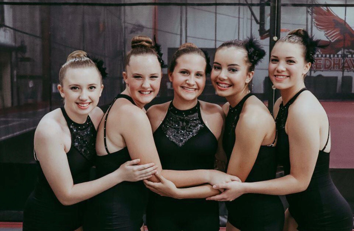 Tori Mogannam, Grace Schneider, Lauren Marcinkiewicz, Elizabeth Simpson and Sarah Uschold take a picture before going on stage for a competition at summer camp.