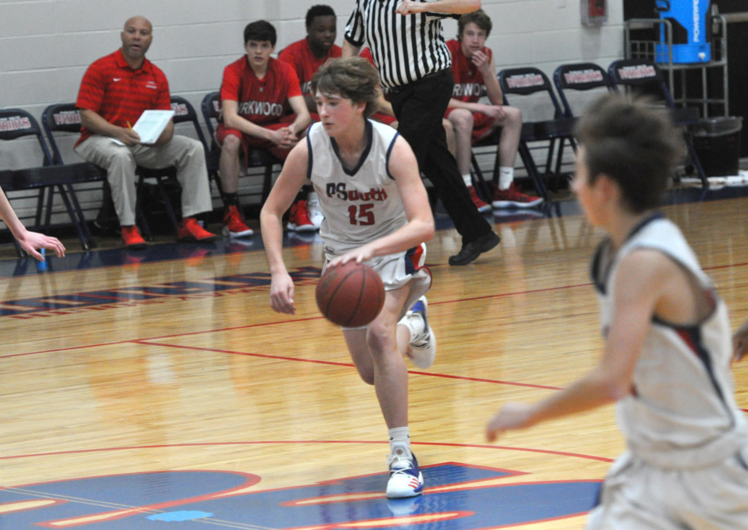 Freshman Owen Veltrop dribbles up the court during a recent freshman basketball game.