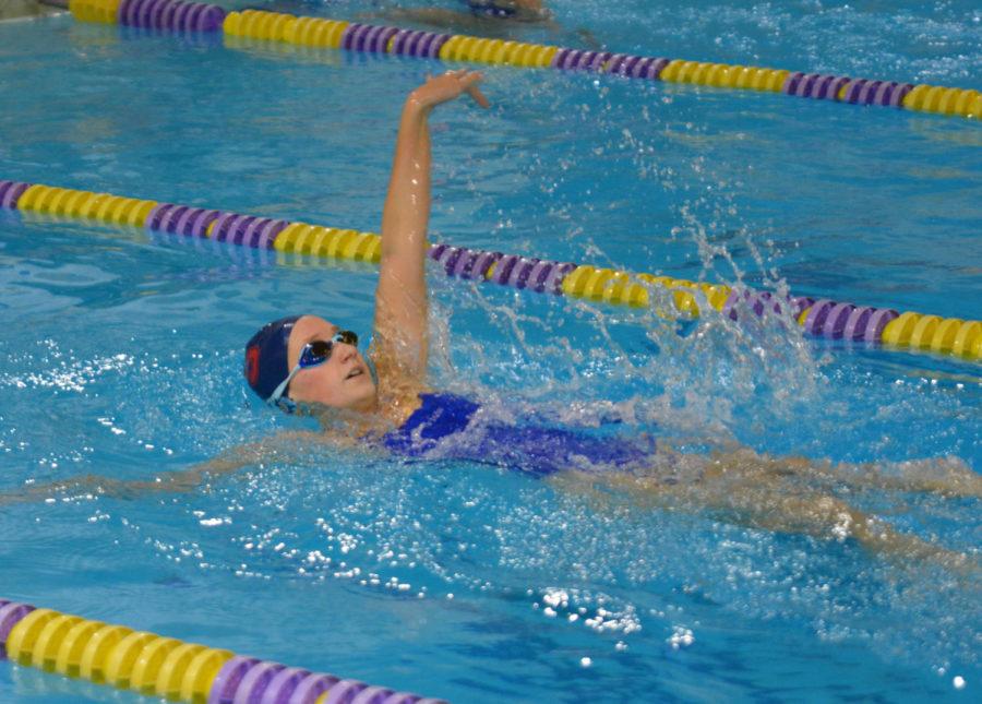 Senior+Madeline+Ryterski+shows+excellent+form+while+swimming+the+backstroke.