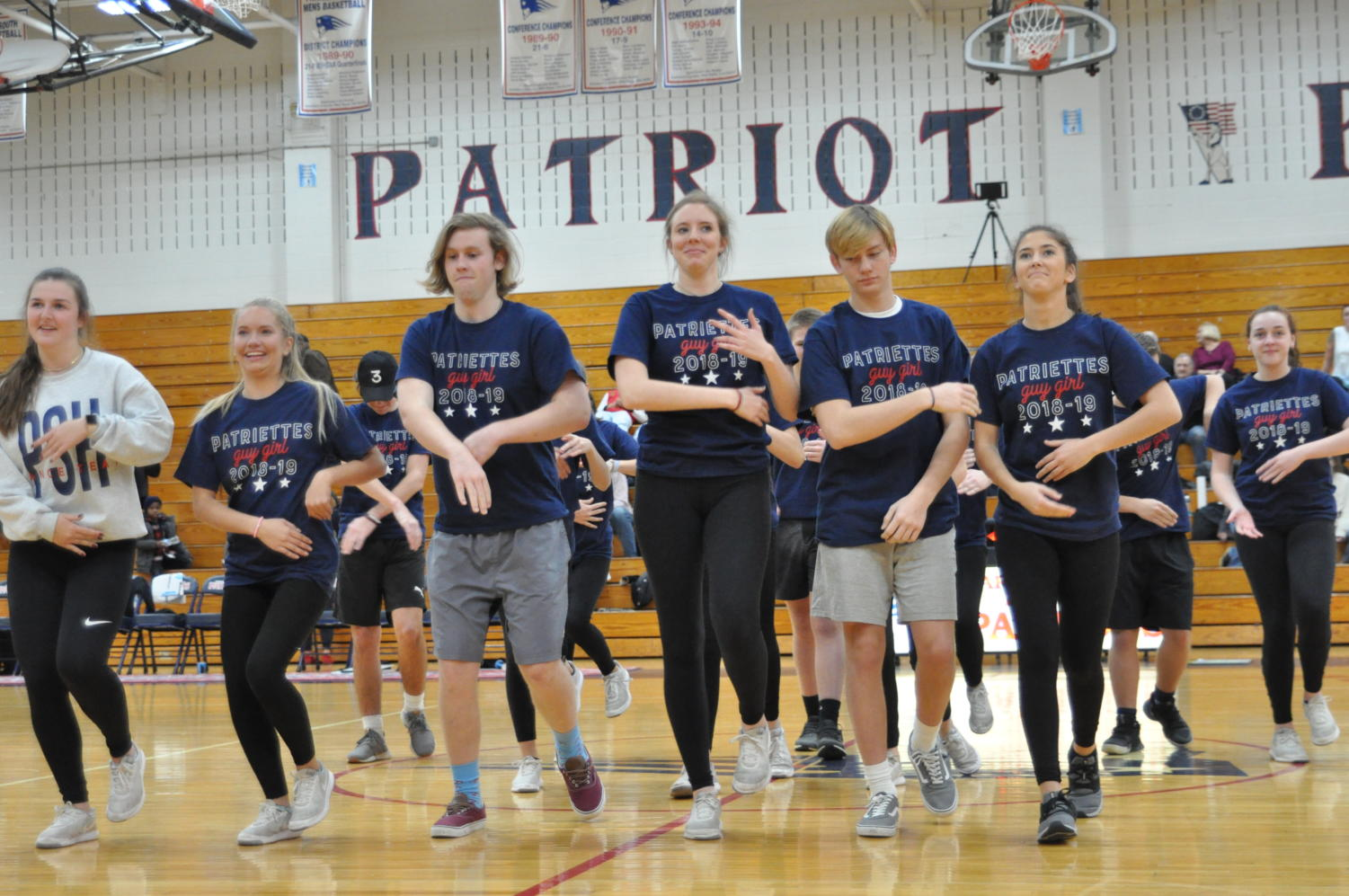 Members of the varsity dance team perform with boys for the Guy/Girl Dance.