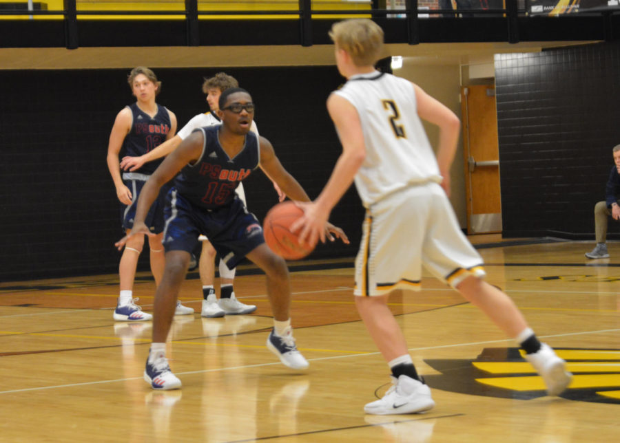 Sophomore+guard+Rhyan+Shanklin+tries+to+prevent+the+opposition+from+scoring.
