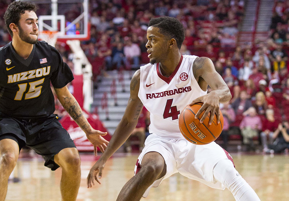 Mizzou guard Jordan Geist defends Daryl Macon of Arkansas in their matchup from last year.