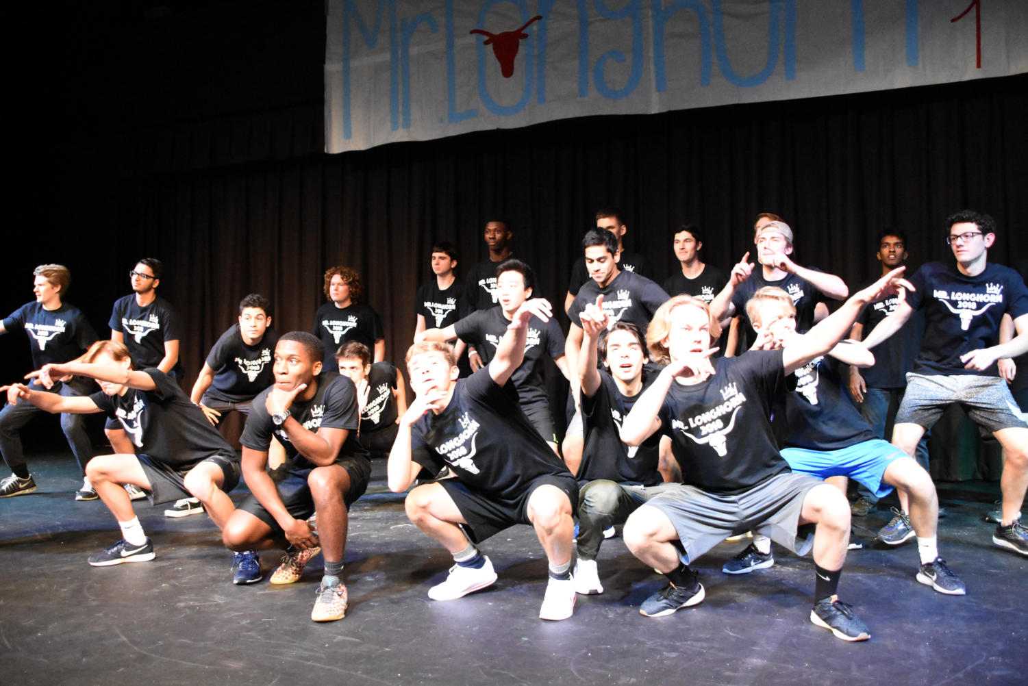The 20 contestants in last year's Mr. Longhorn competition at Parkway West pose for the crowd. At South High, Mr. Patriot was canceled last year for the first time.