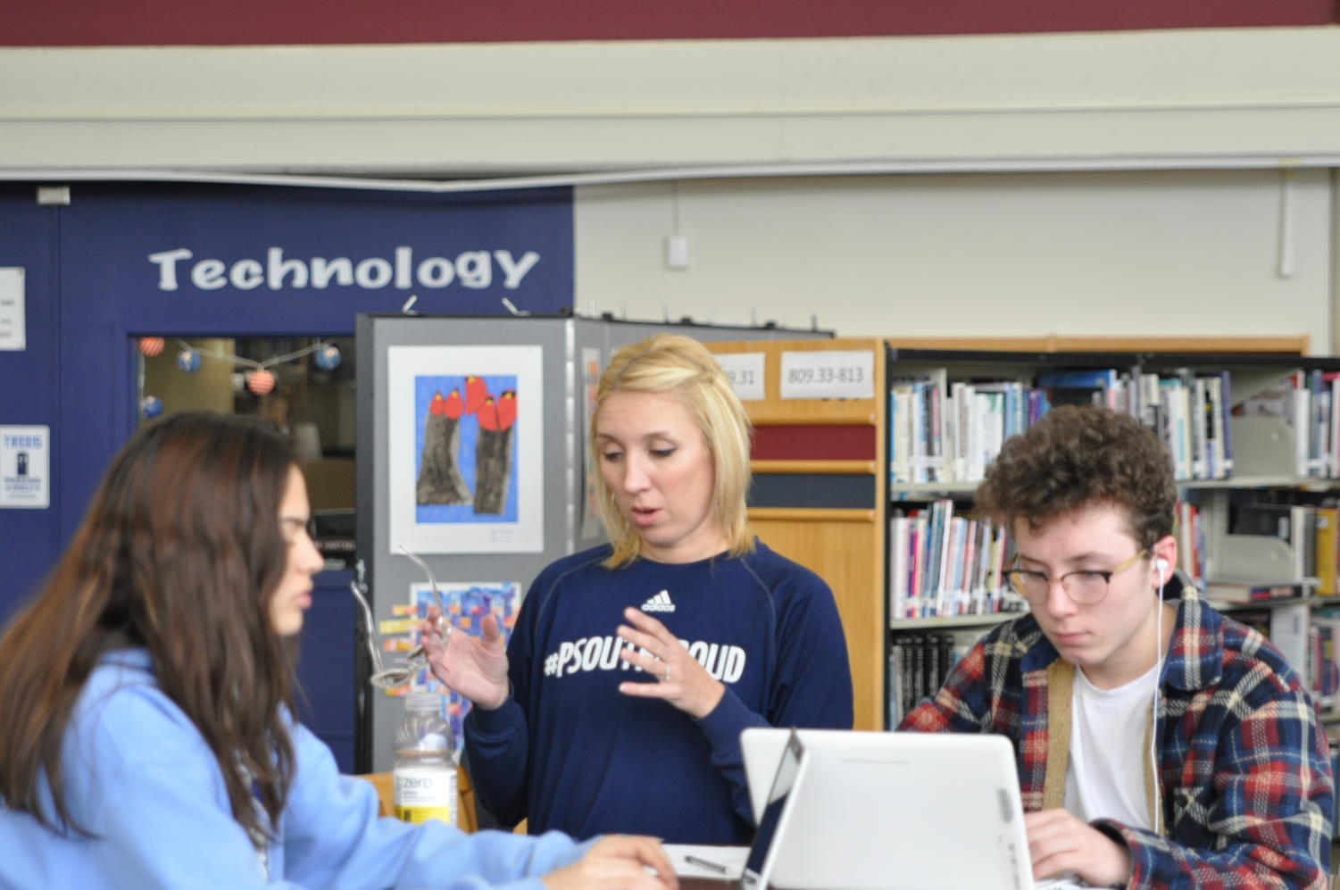Melissa Gebhard works with sophomores Paige Mancuso and Philip Oakley in the library during Histolish.