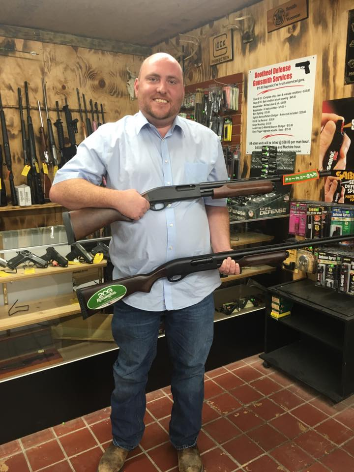 Andrew McDaniel, a Republican Missouri Representative, poses in a gun shop. He has proposed two bills which would require Missourians age 18-35 to own a gun.