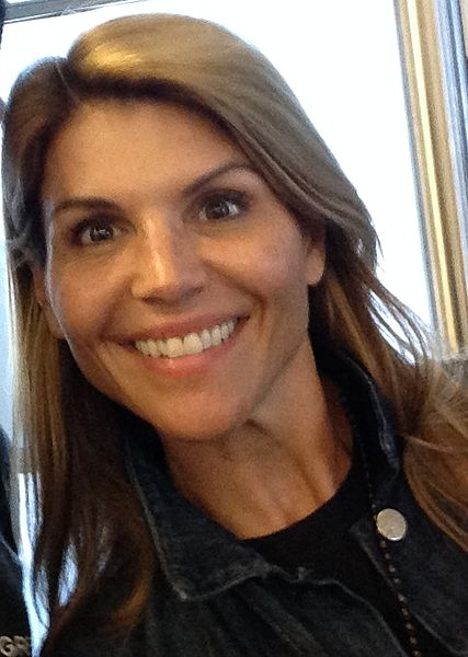 Lori Loughlin, Full House star, is accused of bribing officials to get her two daughter accepted into USC.