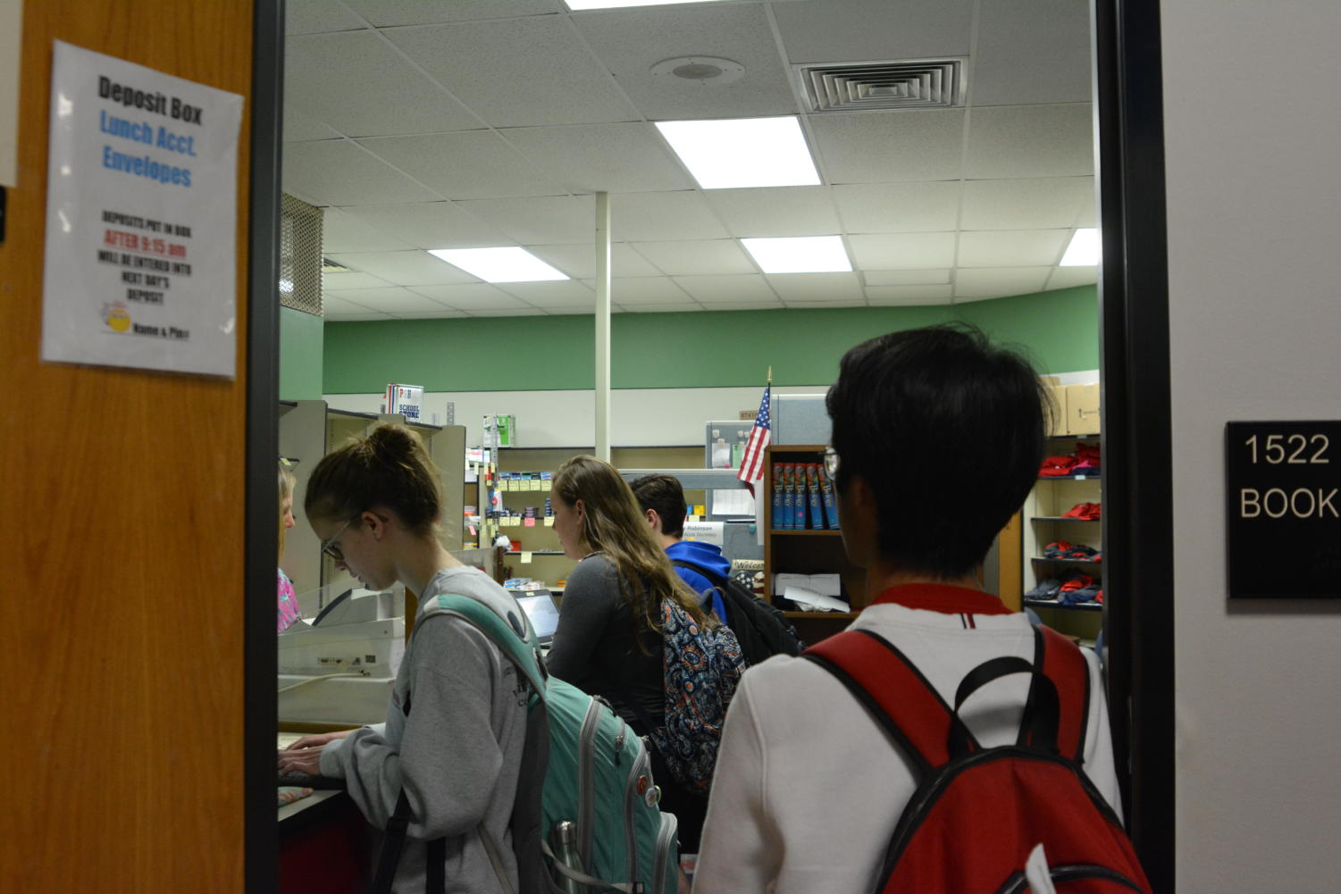 Students line up in the bookstore to purchase their $70 prom tickets.