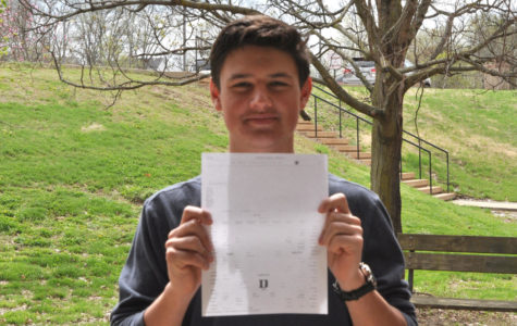 Junior Andrew Meyers holds up his March Madness bracket. He picked Gonzaga to win it all.
