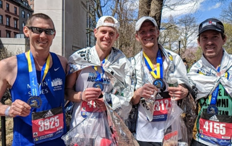 Matt Roach smiles with his friends after finishing the Boston Marathon.