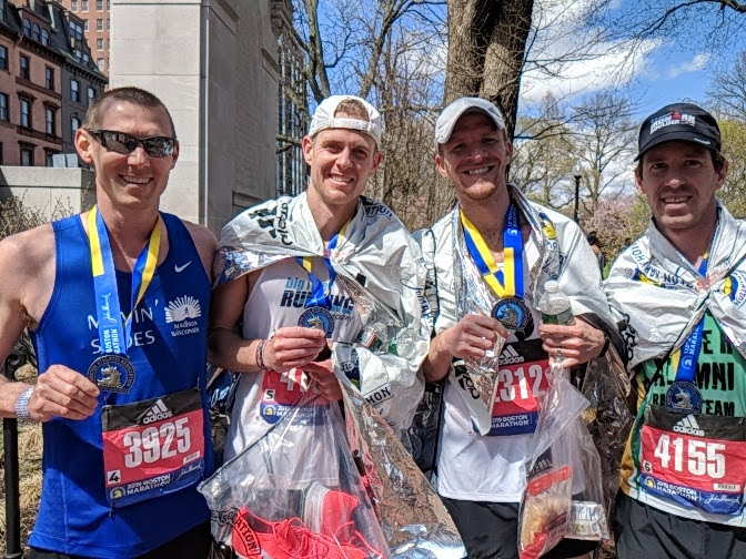 Matt+Roach+smiles+with+his+friends+after+finishing+the+Boston+Marathon.