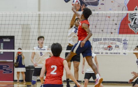Senior Taron Jones leaps in the air to spike the ball in a game against Parkway North.