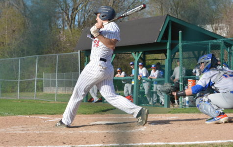 Junior Jack Dittmeier makes contact with the ball during a recent game.