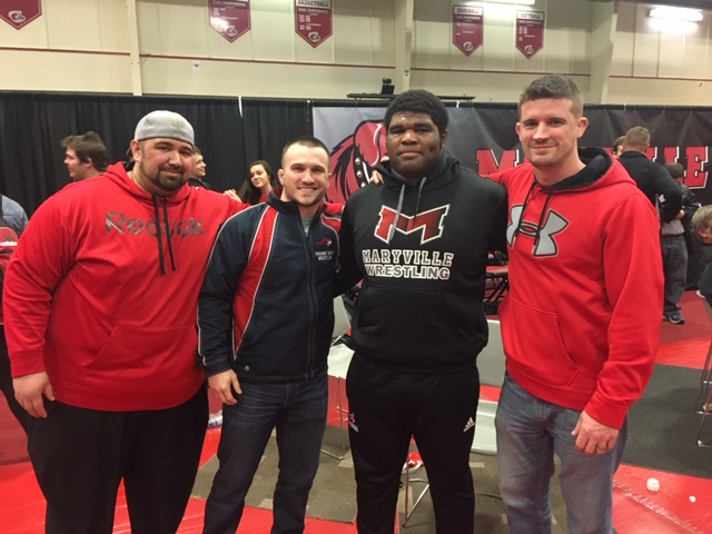Former+wrestling+coach+Jim+Lake+visits+Donnell+Walker+at+a+wrestling+practice+at+Maryville+University.