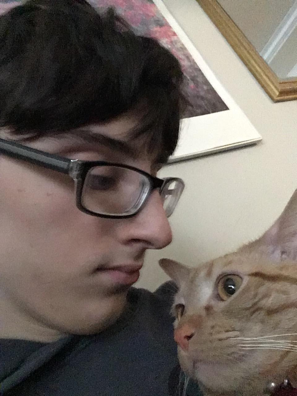 Junior Joseph Hyman takes a selfie with his pet cat.