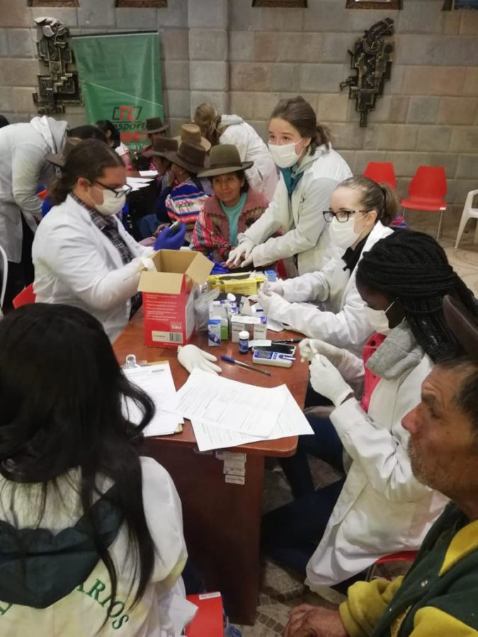 Junior Iris Cameron and other nurses and volunteers prick peoples' fingers to test for Anemia and Diabetes. Cameron traveled to Peru over the summer to learn more about medicine.