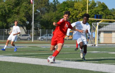 Sophomore midfielder Arya Sabourizadeh tries to keep the ball in bounds while getting away from his Parkway West opponent.