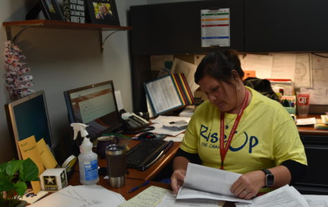 Building manager Lisa Marcinkiewicz works at her desk. Marcinkiewicz is in charge of the drills at South High.
