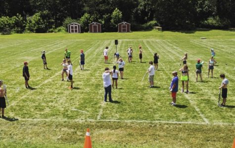Members of the Spirit of '76 marching band practice on the lower field. This year the band had to share the lower field with the football team.