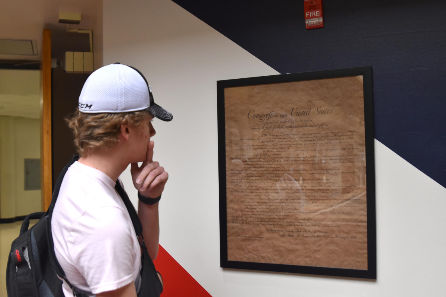 Junior Jason Gifford studies a copy of the Constitution displayed in South High