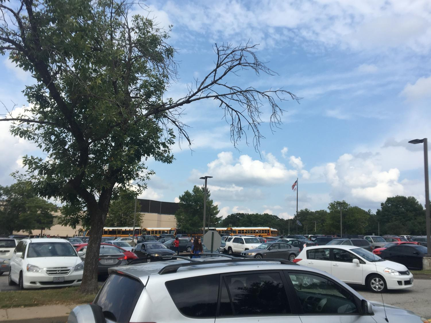 Students wait in traffic to exit the junior lot after school.
