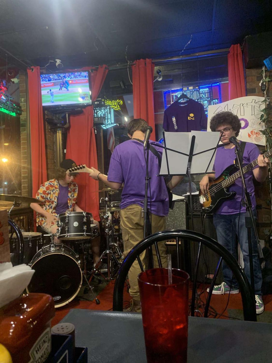 Members of the Lemons play at their gig at Friend's Bar and Grill.