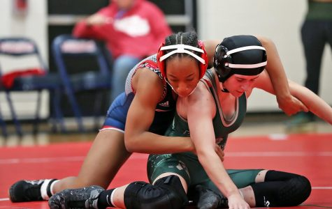 Freshman Janiah Jones attempts to get her LIndbergh opponent to the ground during her match, Dec. 4. Jones earned her first pin ever in the match.