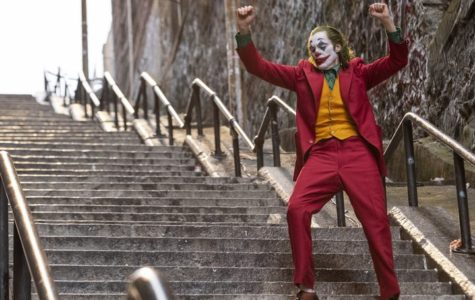 Joaquin Phoenix dances down the staircase in