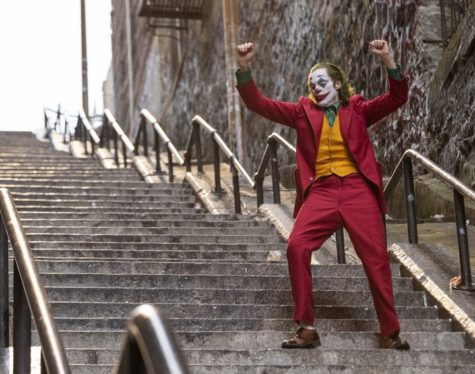 "Joaquin Phoenix dances down the staircase in ""Joker."""