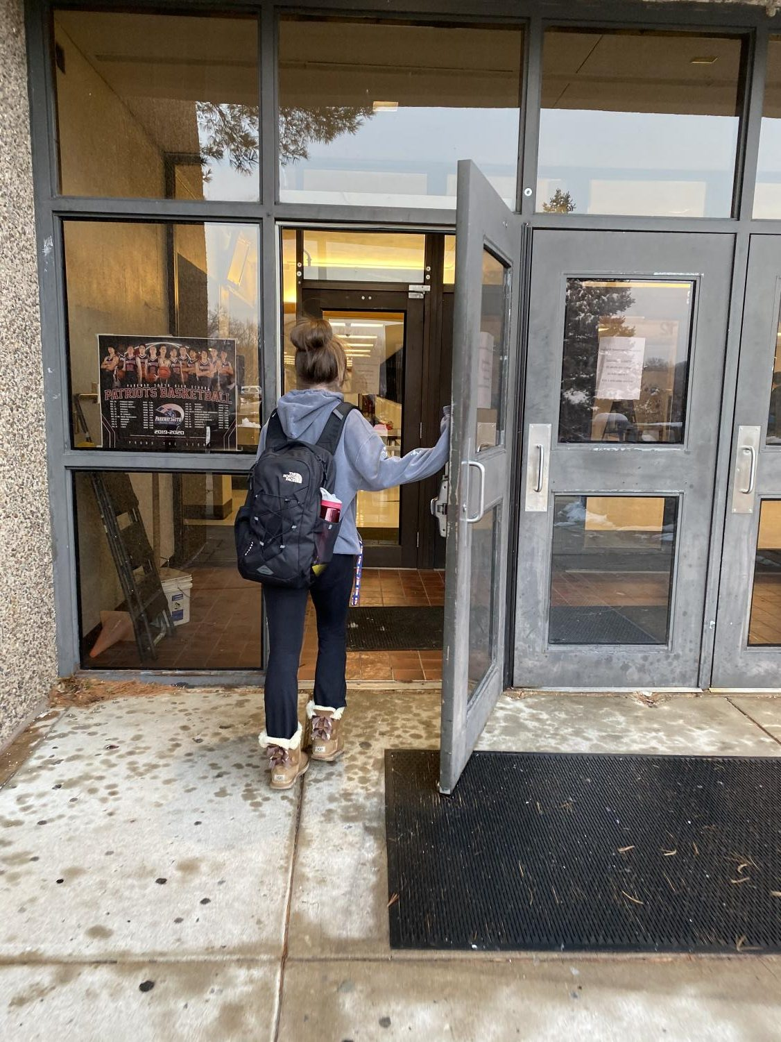 Senior Molly Hogan rushes to get to class on time, Dec. 18.