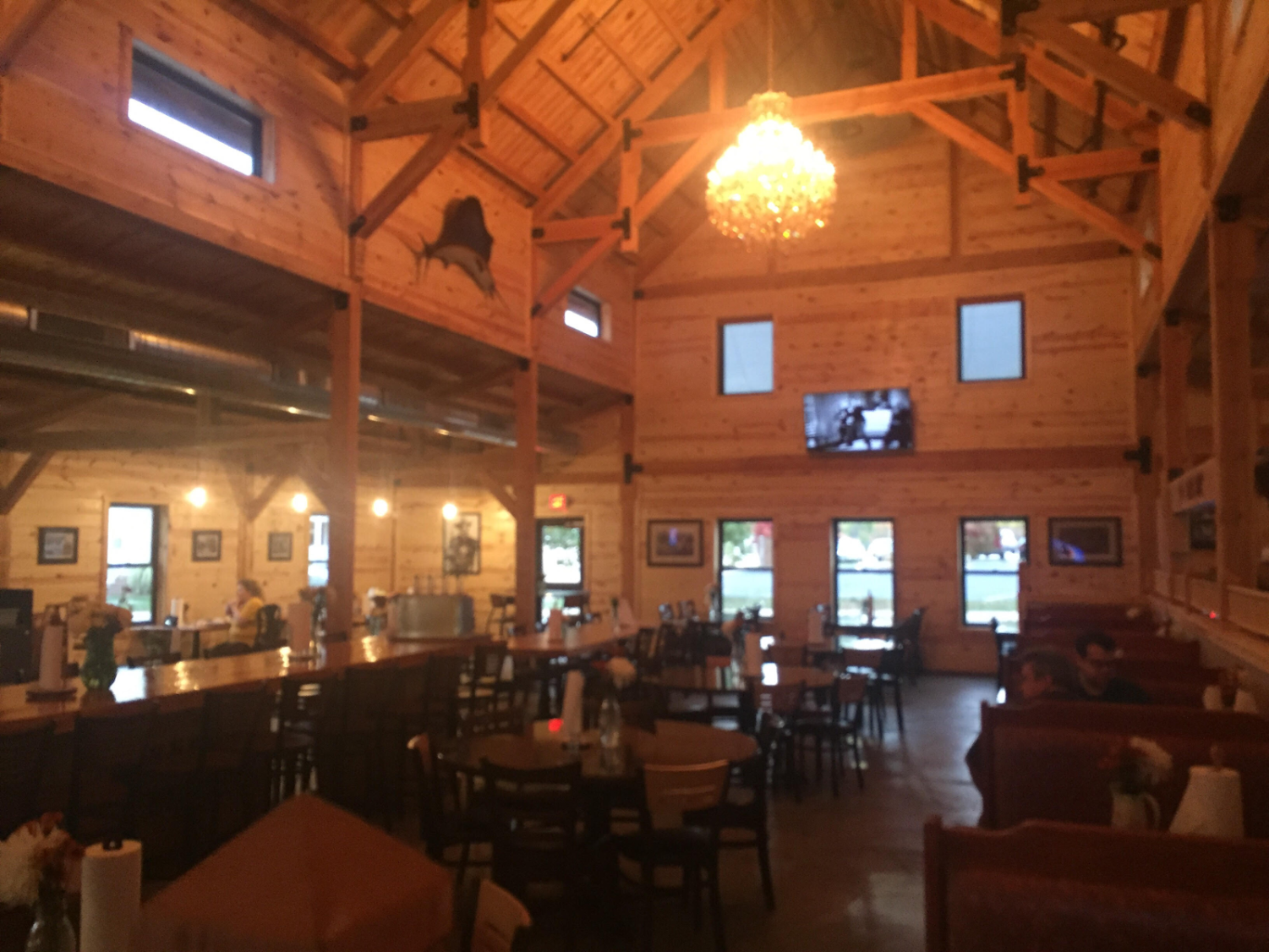 The inside of the Manchester location of Smokee Mo's simulates a barn theme.