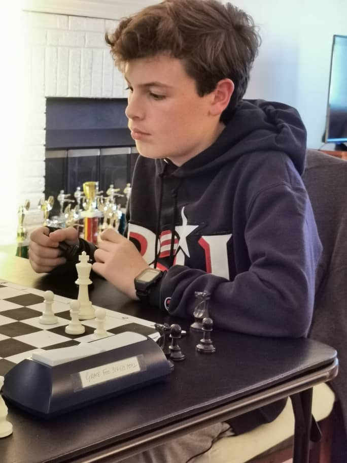 Freshman Cole Tatro studies his next move during a recent chess match.